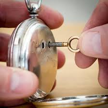 how to wind a pocket watch with key